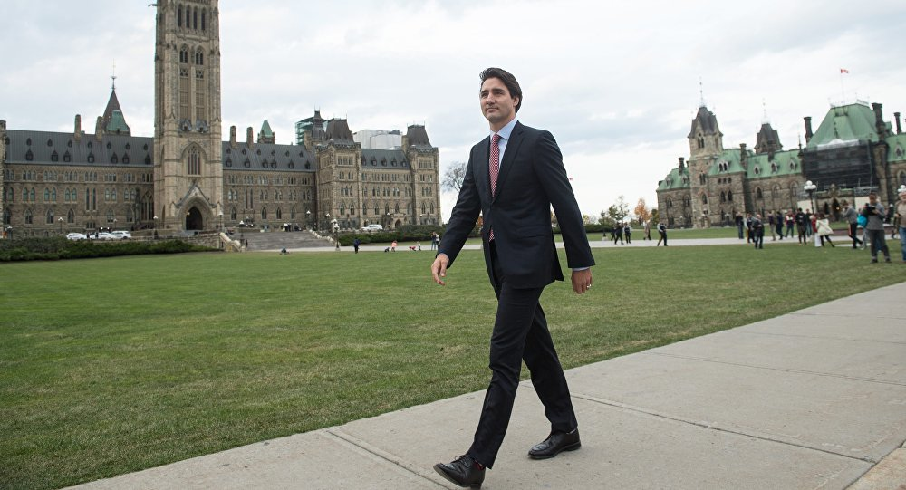 Canadian Liberal Party leader Justin Trudeau walks from the parliament to give a press conference in Ottawa on October 20, 2015 after winning the general elections