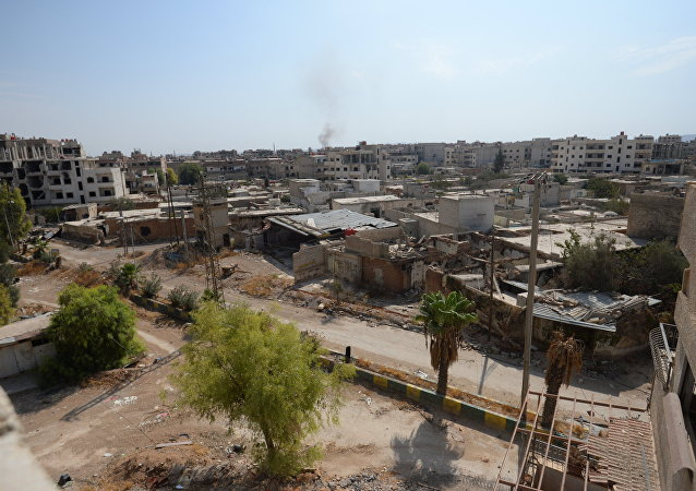 Destroyed buildings in the Darayya suburb of Damascus