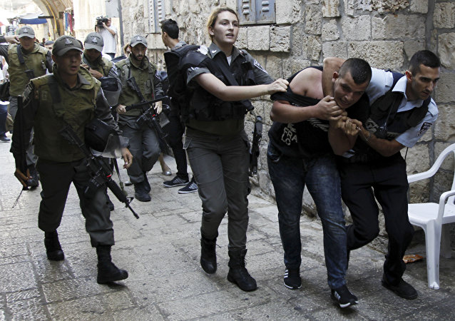 Israeli policemen arrest a Palestinian man during confrontations in the Old City in Jerusalem, Wednesday, Sept. 30, 2015. Tensions over the hilltop revered by Jews as the Temple Mount and by Muslims as the Noble Sanctuary, continued Wednesday as Jews mark the Sukkot holiday