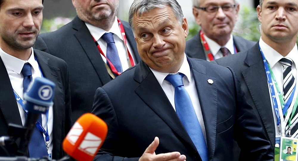 Hungary's Prime Minister Viktor Orban reacts as he arrives at a European Union leaders extraordinary summit on the migrant crisis, in Brussels, Belgium September 23, 2015.