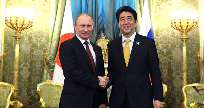 Russian President Vladimir Putin and Prime Minister of Japan Shinzo Abe shake hands prior to their talks in the Kremlin, April 29, 2013