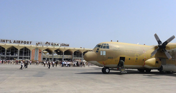 A Saudi military plane carrying relief aid is seen parked on the tarmac at Aden's international airport in Yemen