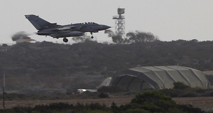 A warplane comes in to land after completed a mission at Britain's Royal Air Force Base in Akrotiri near southern city of Limassol, Cyprus, on Saturday, Sept. 27, 2014. Britain's Ministry of Defense said warplanes have taken off for their first combat mission over Iraq since Parliament approved airstrikes targeting the Islamic State group
