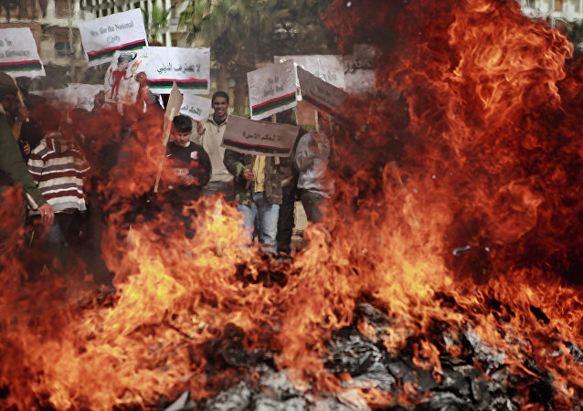 Benghazi residents burn portraits of Muammar Gaddafi