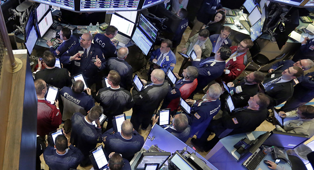 Traders gather at the post that handles Allergan on the floor of the New York Stock Exchange,Thursday, Oct. 29, 2015