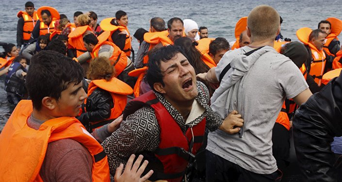 A Syrian refugee cries while disembarking from a flooded raft at a beach on the Greek island of Lesbos, after crossing a part of the Aegean Sea from the Turkish coast on an overcrowded raft, October 20, 2015