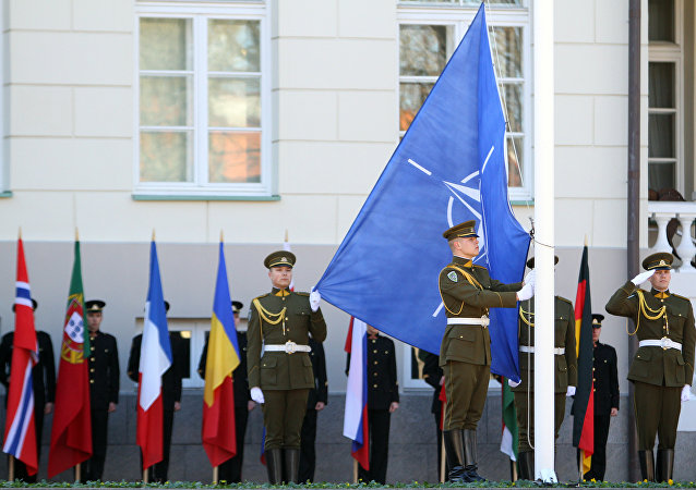 Lithuanian soldiers raise the NATO and Lithuanian flags