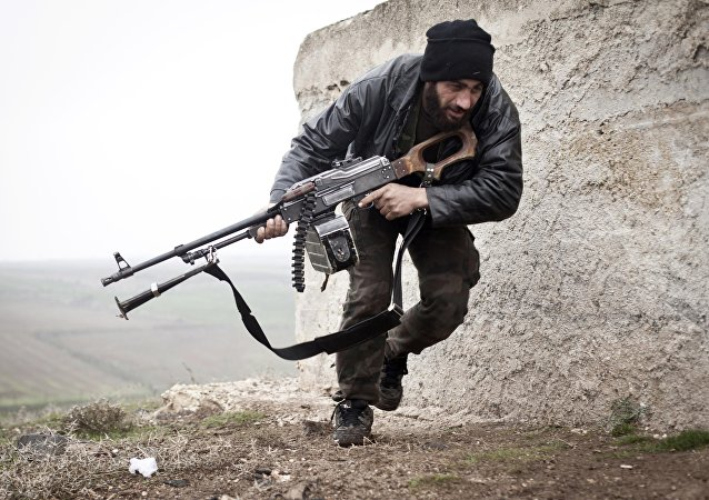 Free Syrian Army fighter takes cover during fighting with the Syrian Army in Azaz, Syria