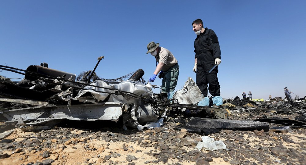 Military investigators from Russia check debris from a Russian airliner at its crash site at the Hassana area in Arish city, north Egypt, November 1, 2015
