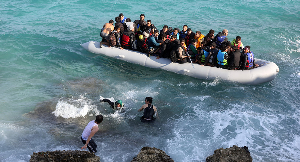 Refugees and migrants board a dingy as they set out, trying to travel from the Turkish coast to the Greek island of Chios, near Cesme, Turkey, Saturday, Oct. 31, 2015.