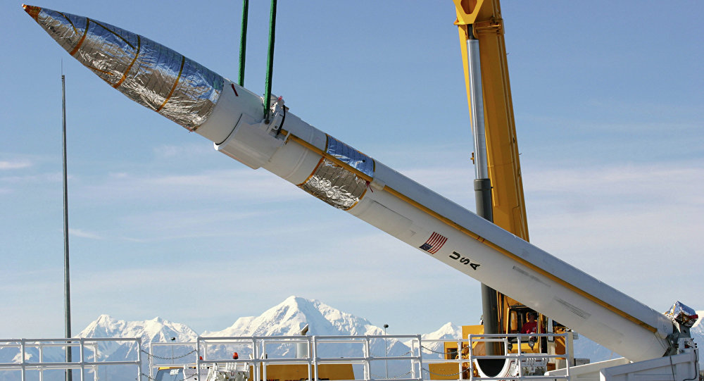 A ground-based missile interceptor is lowered into its missile silo