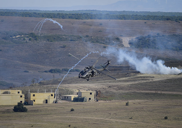 An helicopter takes part in the NATO's Trident Juncture Exercice at San Gregorio training ground near Zaragoza on November 4, 2015.