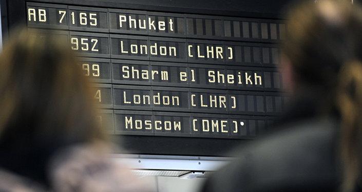 Departure board listing a flight to Egyptian city Sharm el-Sheikh