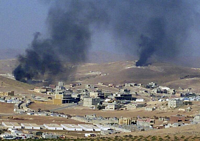 FILE - In this Saturday, Aug. 2, 2014, file photo, smoke billows from the Lebanese town of Arsal, a Sunni Muslim town near the Syrian border in eastern Lebanon.