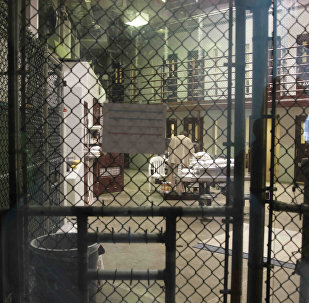 In this file photo, a prisoner stands with his back turned inside Camp 6, a communal unit of the Guantanamo Bay detention center