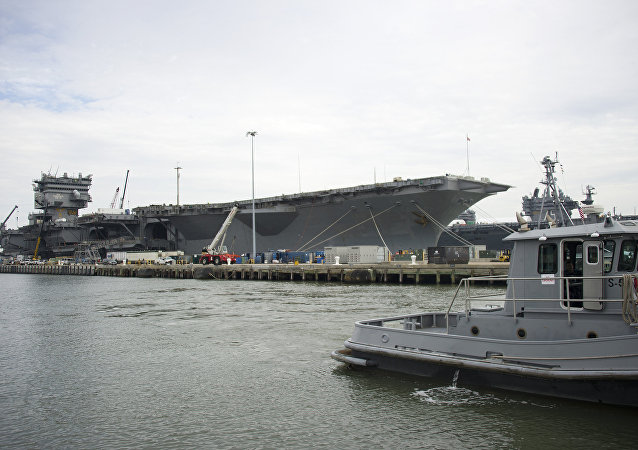 The Navy aircraft carrier USS Enterprise rests at the pier as it is gutted before being official decommissioned at Naval Station Norfolk in Norfolk, Virginia, May 8, 2013, during the Department of Defense's tour deemed Navy 101