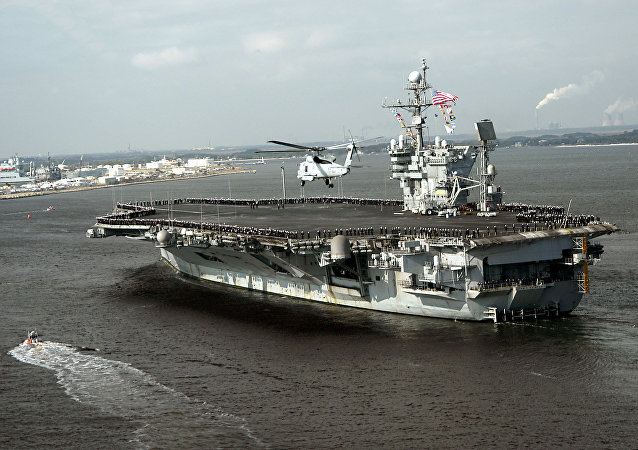 The file photo shows the conventionally powered aircraft carrier USS John F. Kennedy (CV 67) as she returns to her homeport of Mayport, Florida