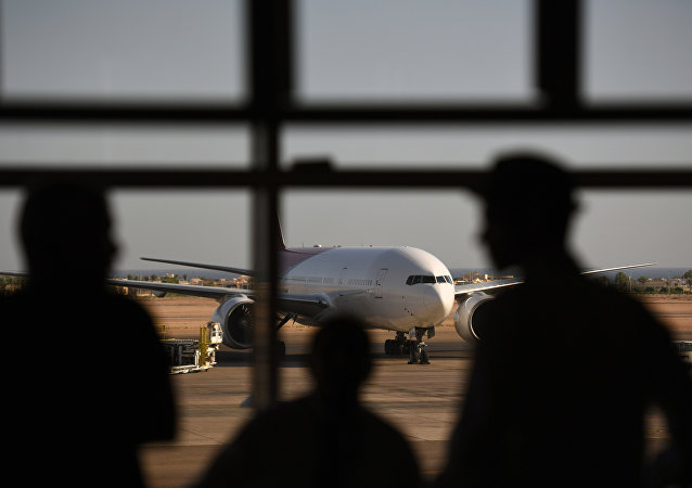 Tourists look out at a Russian plane on the tarmac of the airport in Egypt's Red Sea resort of Sharm el-Sheikh on November 6, 2015