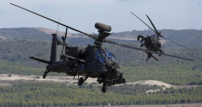 NATO forces in AH-64 Apache helicopters take part in Exercise Trident Juncture 2015