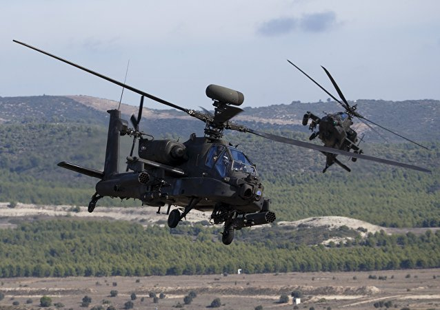 NATO forces in AH-64 Apache helicopters take part in Exercise Trident Juncture 2015, NATO's largest joint and combined military exercise in more than a decade, at the San Gregorio training grounds outside Zaragoza, Spain, November 4, 2015