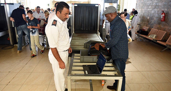Egyptian airport security check passenger's luggage as they pass through security in Egypt's Red Sea resort of Sharm El-Sheikh on November 6, 2015