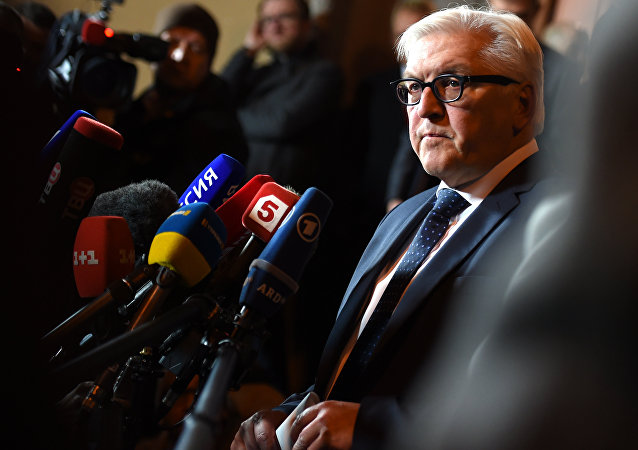 German Foreign Minister Frank-Walter Steinmeier speaks to journalists after a meeting with his French, Russian and Ukrainian counterparts at Villa Borsig, the foreign ministry's guesthouse, in Berlin on November 6, 2015