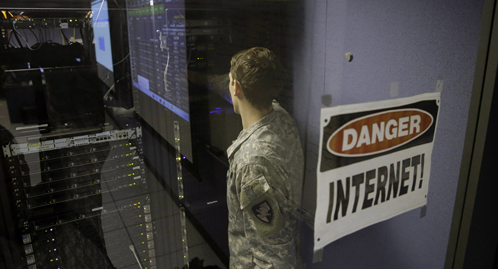 A United States Military Academy cadet checks computers at the Cyber Research Center at the United States Military Academy in West Point, N.Y., Wednesday, April 9, 2014