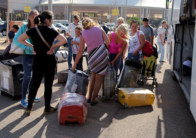 Russian tourists double pack their luggages that will be shipped separately for more security on board the airplane at the airport of the Red Sea resort of Sharm el-Sheikh, November 7, 2015