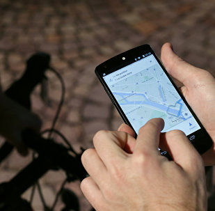 A man uses a GPS app on a smartphone during a Google promotion event at the City of Fashion and Design (Cite de la mode et du design) in Paris on November 4, 2014