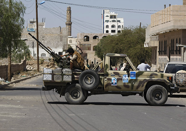 Houthi Shiite rebel mans a machine gun mounted on a military truck in Sanaa, Yemen, Monday, Oct. 20, 2014