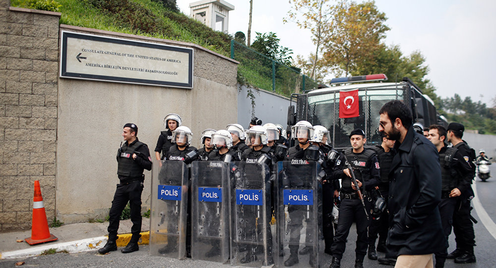 Riot police officers stand as members of Turkey Youth Union shout anti-US slogans as they protest against the upcoming visit of the US President Barack Obama to Turkey mid-November for G20 summit in Antalya, outside the US consulate in Istanbul, Turkey, Sunday, Nov. 8, 2015