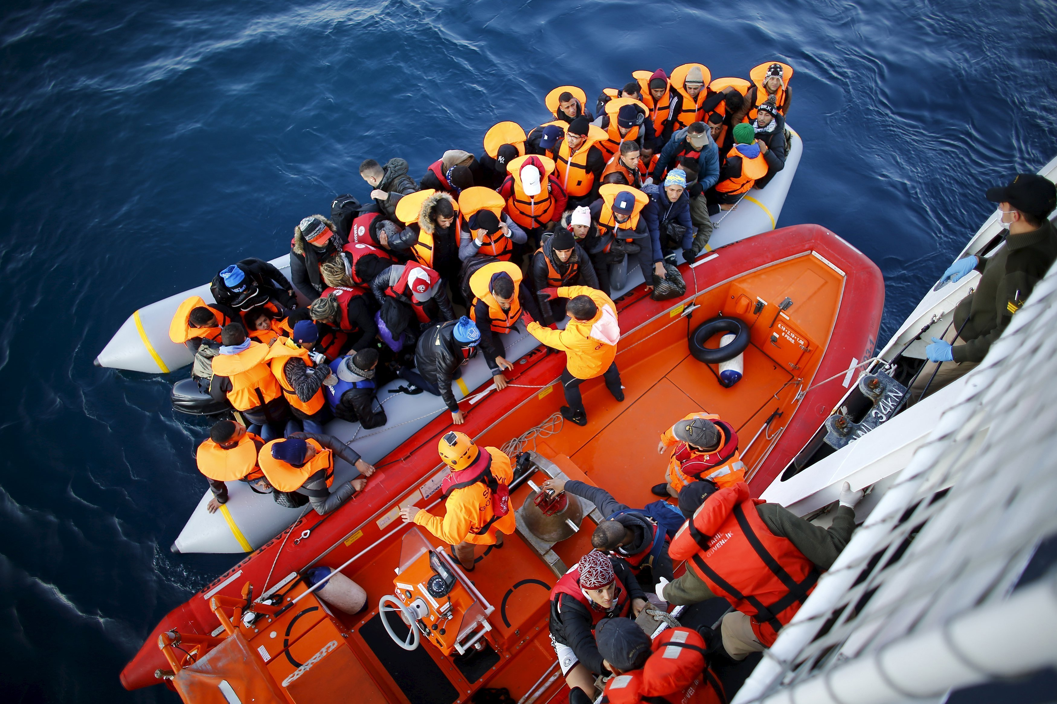 Refugees and migrants board the Turkish Coast Guard Search and Rescue ship Umut-703, off the shores of Canakkale, Turkey, after a failed attempt at crossing to the Greek island of Lesbos, November 9, 2015