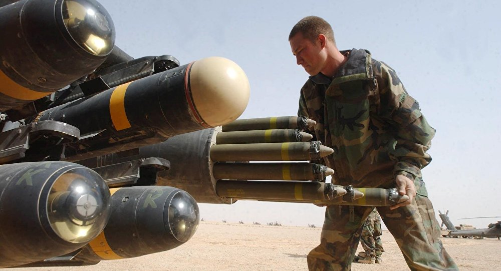 US Army armament crew specialist Michael Mayo loads the rocket pod of an an Apache AH-64D attack helicopter. File photo