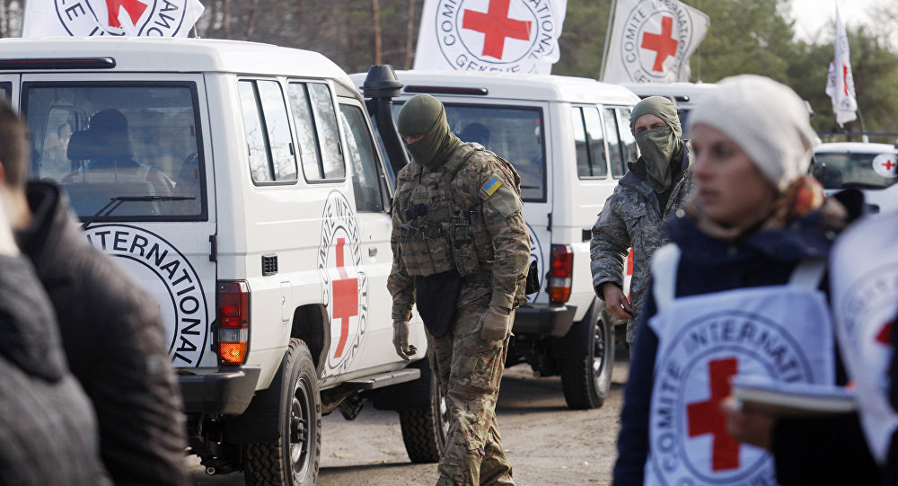 In this file photo Red Cross observers watch a captive exchange in the small Ukrainian town of Schastya, Lugansk.