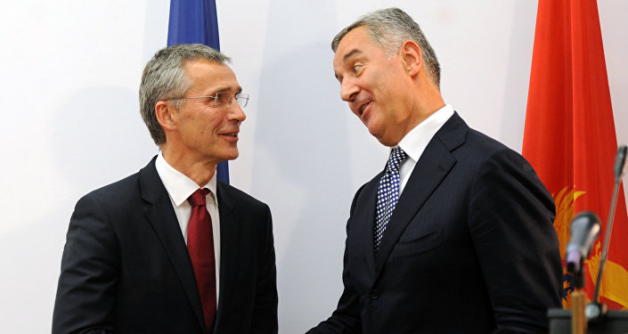 Montenegro's former Prime Minister Milo Djukanovic (R) shakes hands with NATO Secretary General Jens Stoltenberg after a joint press conference in Podgorica, October 2015