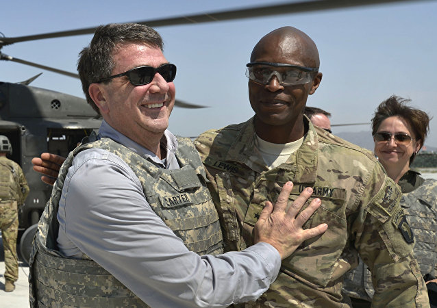 In this photo provided by the Department of Defense, then-U.S. Army Brig. Gen. Ron Lewis, right, greets then-Deputy Secretary of Defense Ash Carter, left, in Jalalabad, Afghanistan, May 13, 2013