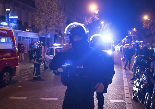 Elite police officers arrive outside the Bataclan theater in Paris, France, Wednesday, Nov. 13, 2015.