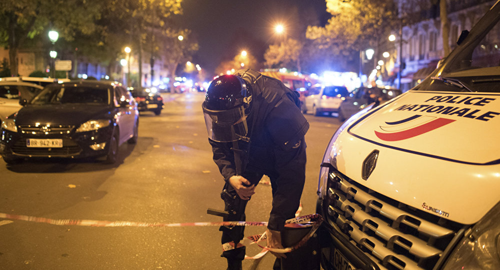 A police officer secures the area outside the Bataclan theater in Paris, France, Wednesday, Nov. 13, 2015.