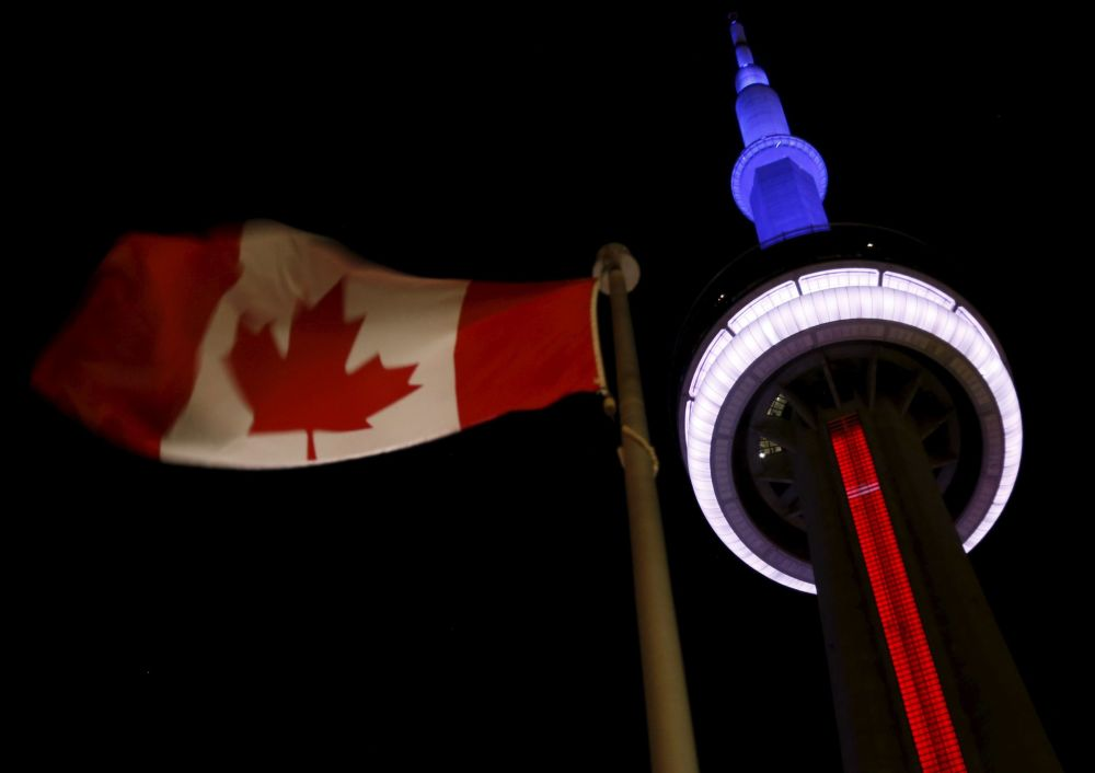 The CN Tower (French: Tour CN) in Toronto is lit up in the colors of the French flag in commemoration of the victims of November 13th's deadly Parisian attacks, that claimed the lives of at least 129 people.