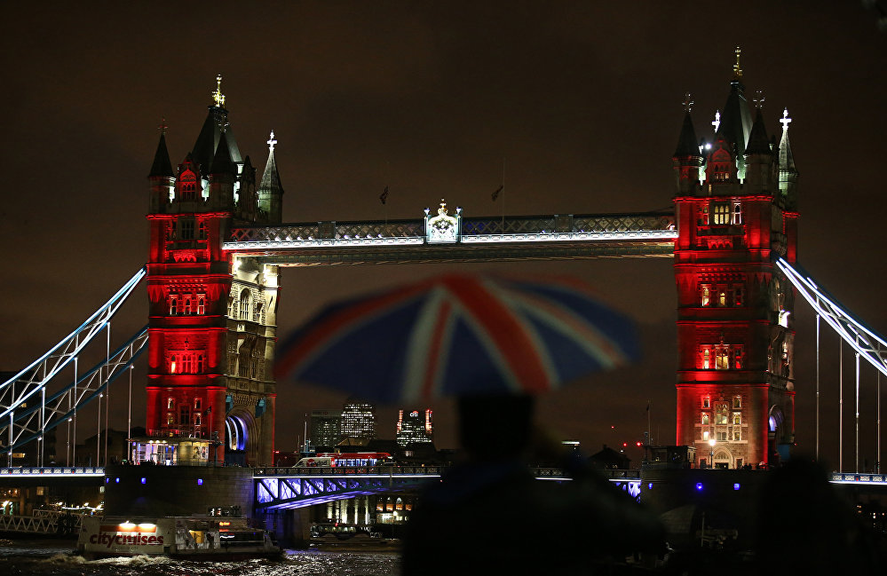 London's iconic Tower Bridge is illuminated in blue, white and red lights, resembling the colors of the French national flag as Britons express their solidarity with France following a spate of coordinated attacks that left 128 dead in Paris on November 13.