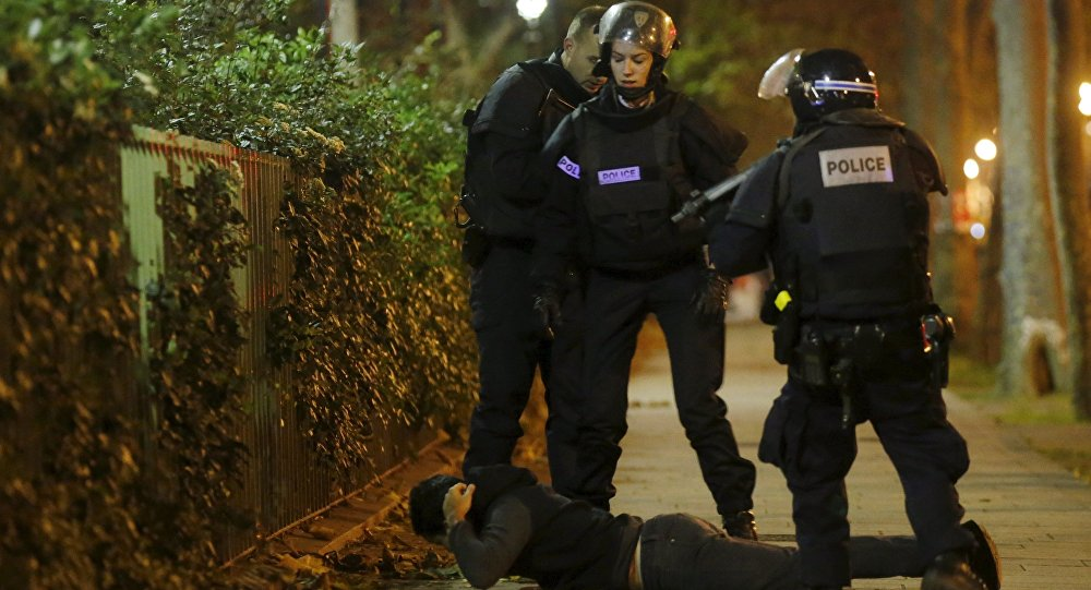A man lies on the ground as French police check his identity near the Bataclan concert hall following fatal shootings in Paris, France, November 13, 2015