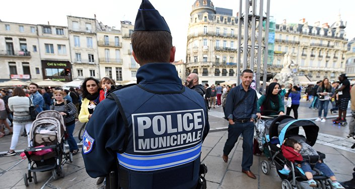 A police officer patrols in Montpellier on November 14, 2015, following a series of coordinated attacks in and around Paris late on November 13