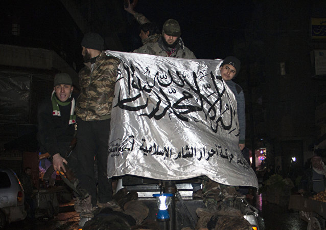 Opposition fighters, wave the flag of Ahrar al-Sham brigade, as they parade in the northern Syrian city of Aleppo on February 19, 2015 the bodies of alleged government troops they said were killed in recent clashes in the Aleppo region