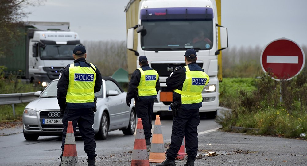 French police officers provide security as they control the crossing of vehicles on the border between the two countries, following the deadly Paris attacks, in Crespin, France, November 14, 2015