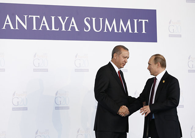Turkish President Recep Tayyip Erdogan (L) greets Russian President Vladimir Putin (R) during the 'Welcoming Ceremony' prior to the G20 Turkey Leaders Summit on November 15, 2015 in Antalya