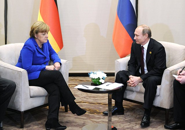 November 15, 2015. Russian President Vladimir Putin and German Chancellor Angela Merkel during a meeting on the sidelines of the Group of 20 summit in Antalya, Turkey