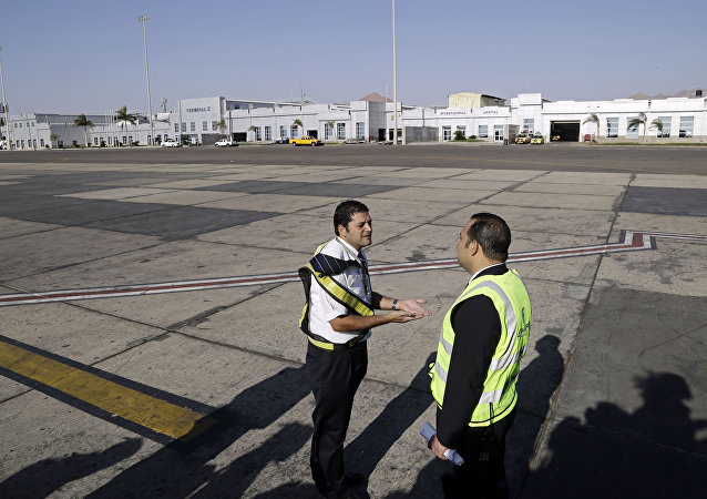 Ground personnel oversee the departure of an Egyptair Express flight bound for Cairo at Sharm el-Sheikh Airport in south Sinai, Egypt.