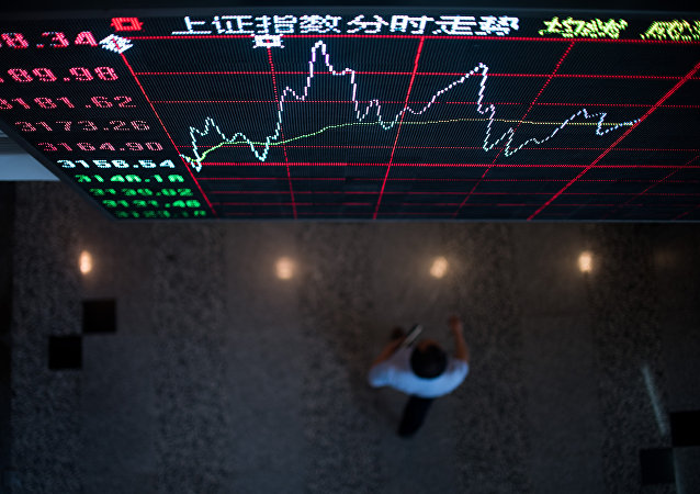 A board shows the stock movements inside the Shanghai Stock Exchange in the Lujiazui Financial district of Shanghai on September 22, 2015