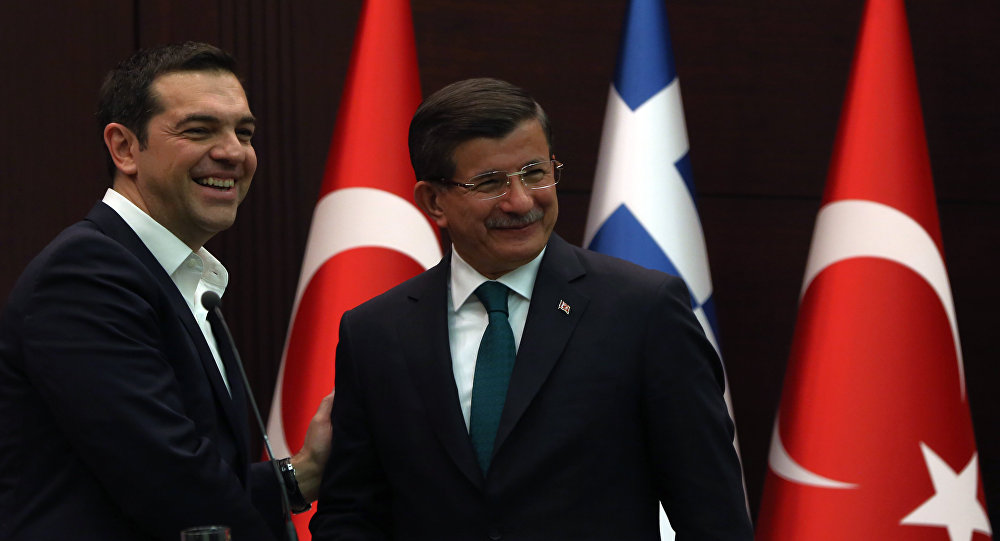 Greece's Prime Minister Alexis Tsipras, left, and his Turkish counterpart Ahmet Davutoglu shake hands after a joint news conference at Cankaya Palace in Ankara, Turkey, Wednesday, Nov. 18, 2015.