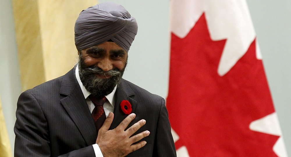 Canada's new National Defence Minister Harjit Sajjan gestures after being sworn-in during a ceremony at Rideau Hall in Ottawa, Canada, November 4, 2015.
